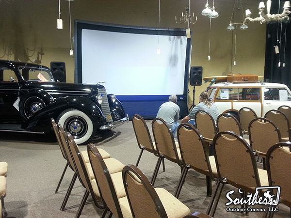 Indoor movie during a car auction in Atlanta